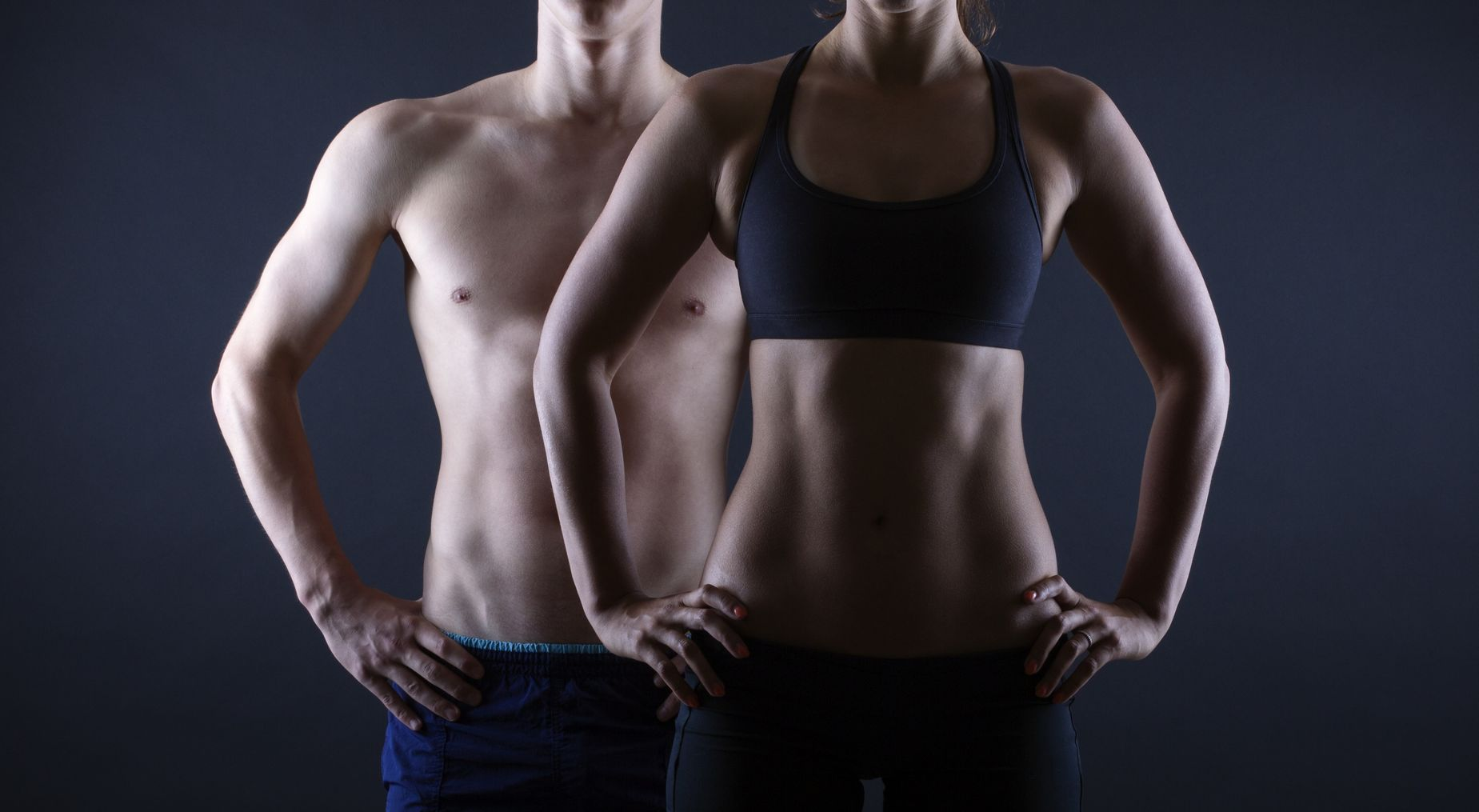 The Key to Weight Loss. Man and woman's fit torso.